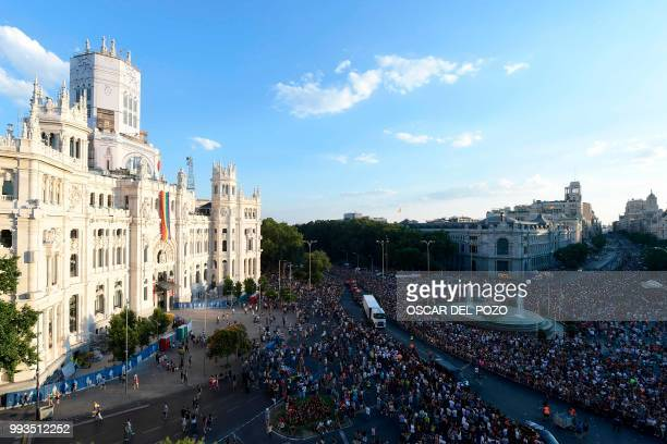 Revellers gather in front the Cibeles Palace Madrid's City Hall during the Gay Pride 2018 parade in Madrid on July 7 one of the world's biggest