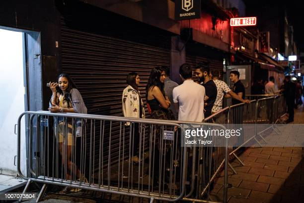 Revellers gather in the smoking area outside the Nest nightclub in Dalston the weekend before new licensing rules come in to effect across Hackney on...