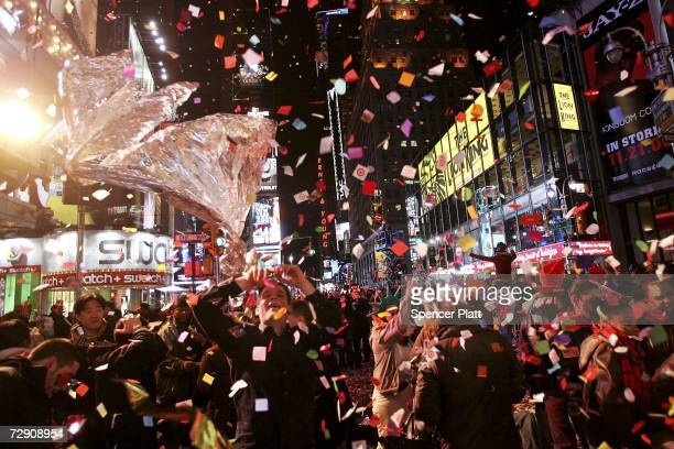 Revellers gather in Times Square on New Years Eve January 1 2007 in New York City People from around the globe watched the famous ball drop at...