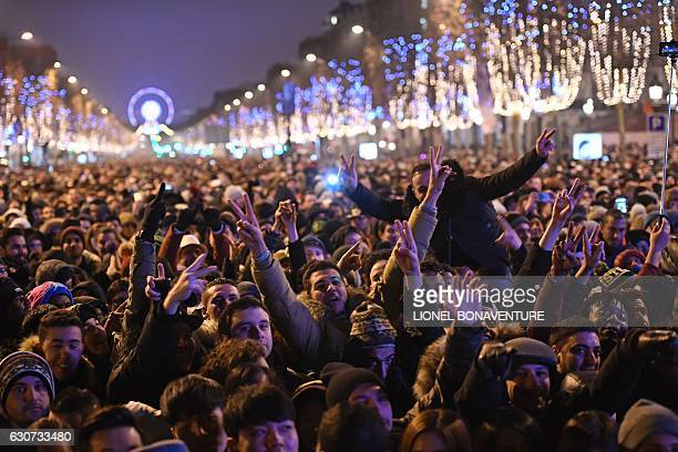 Revellers gather on the ChampsElysees avenue to watch a laser and 3D video mapping show on the theme of the Paris bid for the 2024 Olympic Games...