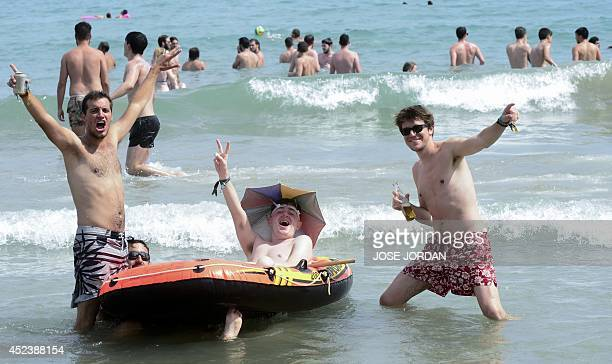 Revellers have fun on a beach during the Benicassim International Festival in Benicassim Castellon province on July 19 2014 The FIB runs from July 17...