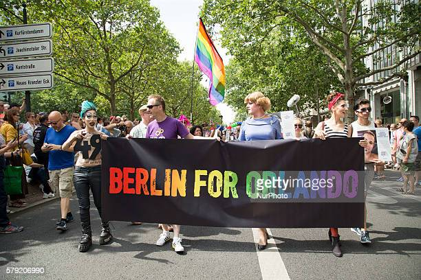 Revellers hold a banner reading 'Berlin for Orlando' at the Christopher Street Day parade in Berlin Germany on July 23 2016 Motto of the annual...