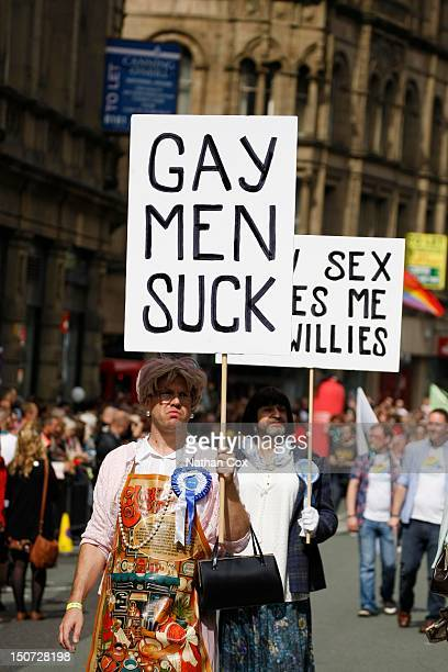 Revellers holds placards attend Manchester Pride 2012 on August 24 2012 in Manchester England