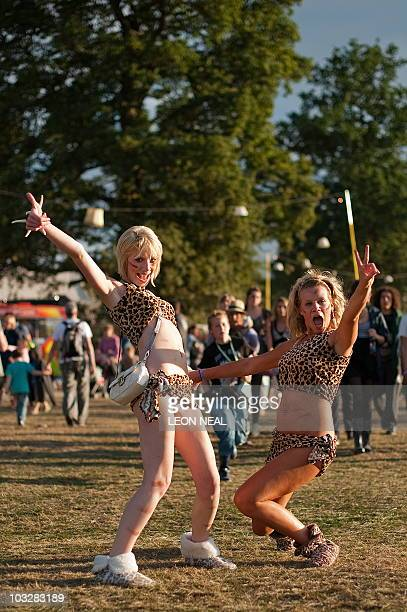 Revellers in cavewoman costumes enjoy the evening sun at the Big Chill festival near Ledbury in Herefordshire on August 7 2010 Running from the 5th...