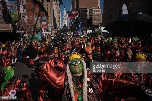 Revellers in fancy dress participate in the annual Mummers Parade in Philadelphia on January 1 2017 The Mummers Parade is a 120yearold folk festival...