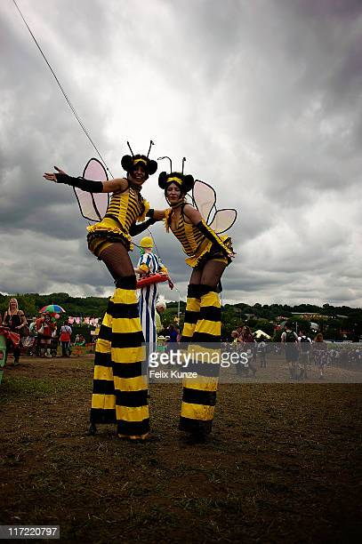Revellers in fancy dress soak up the atmopshere during the second day of Glastonbury Festival 2011 at Worthy Farm on June 24, 2011 in Glastonbury,...