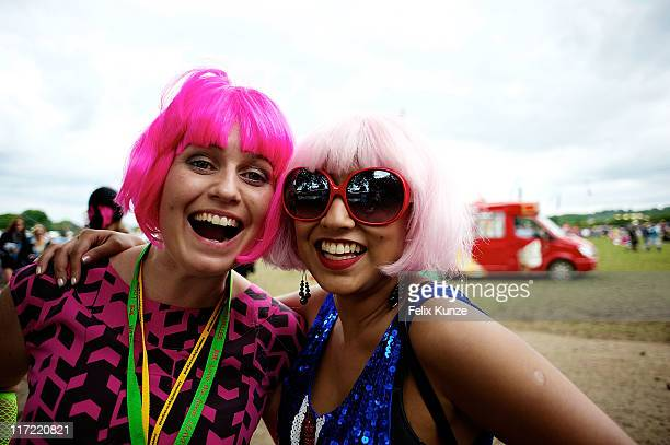 Revellers in fancy dress soak up the atmopshere during the second day of Glastonbury Festival 2011 at Worthy Farm on June 24 2011 in Glastonbury...