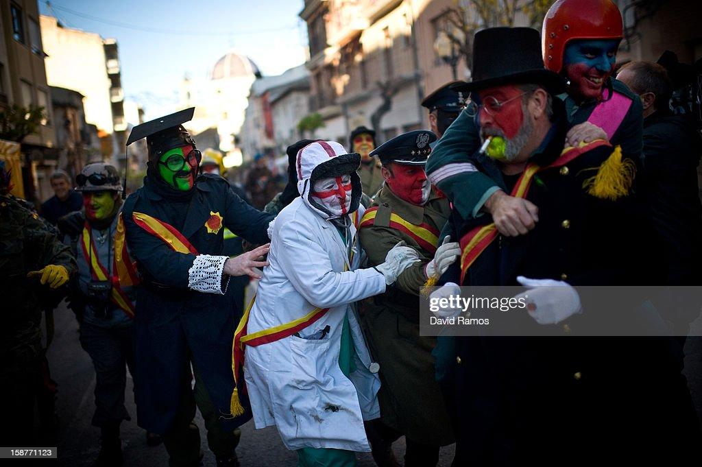 Revellers in fancy dress walk toward the battle of 'Enfarinats', a flour fight in celebration of the Els Enfarinats festival on December 28, 2012 in Ibi, Spain. Citizens of Ibi annually celebrate the festival with a battle using flour, eggs and firecrackers. The battle takes place between two groups, a group of married men called 'Els Enfarinats' which take the control of the village for one day pronouncing a whole of ridiculous laws and fining the citizens that infringe them and a group called 'La Oposicio' which try to restore order. At the end of the day the money collected from the fines is donated to charitable causes in the village. The festival has been celebrated since 1981 after the town of Ibi recovered the tradition but the origins remain unknown.Ê