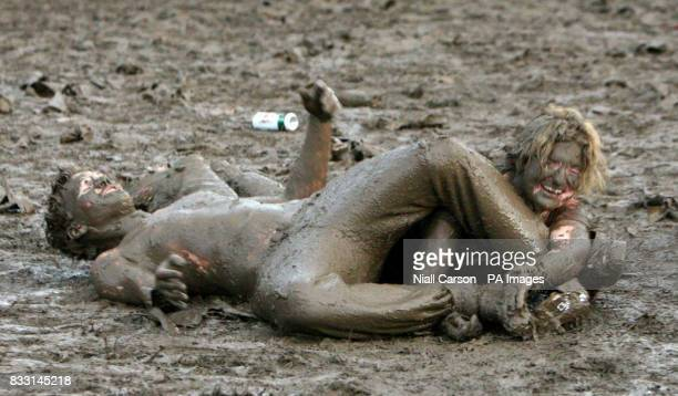Revellers indulges in some mud wrestling at the Oxegen Music festival at Punchestown racecourse Co Kildare