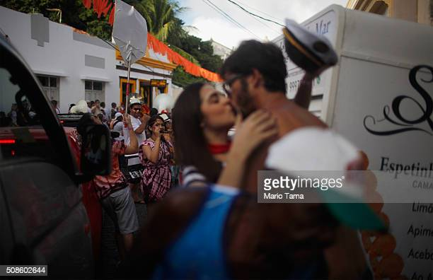 Revellers kiss during a street party on the first official day of Carnival February 5 2016 in Olinda Pernambuco state Brazil Officials say as many as...