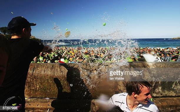 Revellers launch water balloons into the air during a world record attempt to stage the world's biggest water balloon fight April 22 2006 in Sydney...