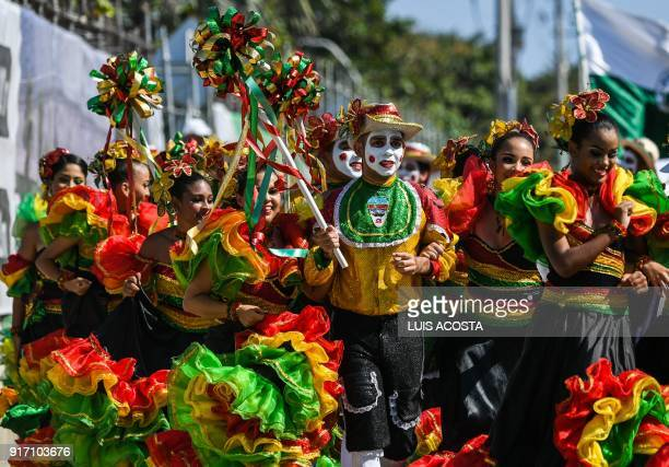 Revellers named Congo during the Carnival parade in Barranquilla Colombia on February 11 2018 / AFP PHOTO / Luis ACOSTA