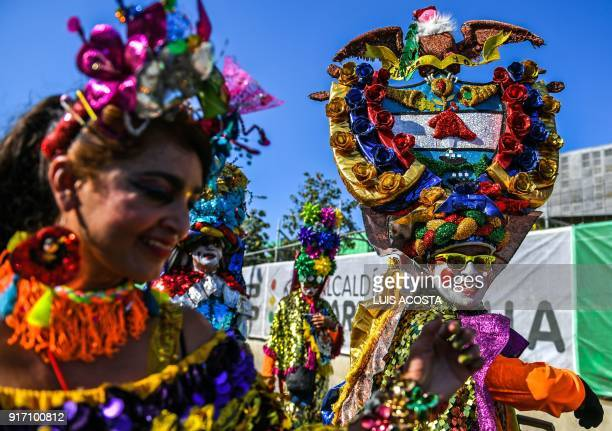 Revellers named 'Congos' dance during the Carnival parade in Barranquilla Colombia on February 11 2018 / AFP PHOTO / Luis ACOSTA