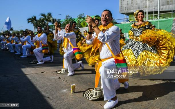 Revellers named 'Cumbiambas' dance during the Carnival parade in Barranquilla Colombia on February 11 2018 / AFP PHOTO / Luis ACOSTA