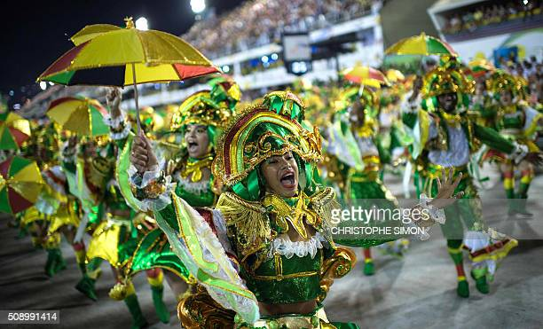 Revellers of Beija Flor samba school perform during the first night of the carnival parade at the Sambadrome in Rio de Janeiro Brazil on february 08...