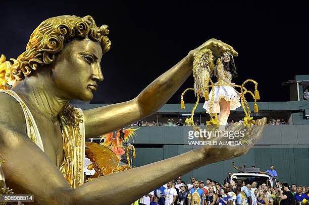 Revellers of BeijaFlor samba school perform during the first night of the carnival parade at Sambadrome in Rio de Janeiro Brazil on February 8 2016 /...