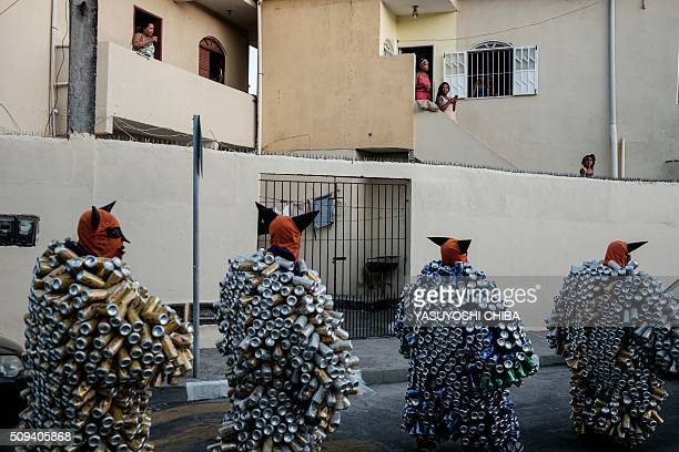 Revellers of Bloco da Latinha a street carnival group march during a parade on the last day of carnival in Madre de Deus Bahia State Brazil on...