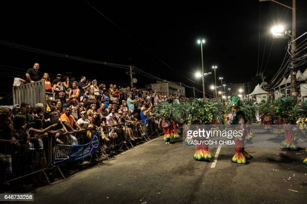 Revellers of Caprichosos de Pilares samba school perform during their parade on Intendente Magalhaes street in Rio de Janeiro Brazil on February 28...