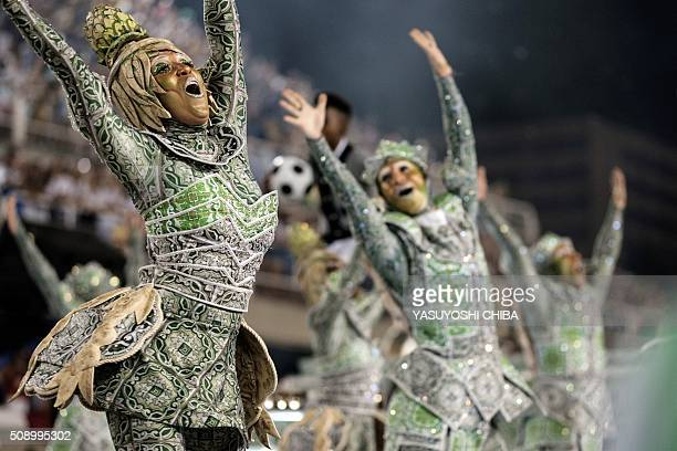 Revellers of Grande Rio samba school perform during the first night of the carnival parade at Sambadrome in Rio de Janeiro Brazil on February 8 2016...