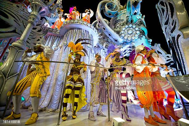 Revellers of Salgueiro samba school dance along on their parade as part of the 2013 Brazilian Carnival at Sapucaí Smbodrome on February 10 2013 in...