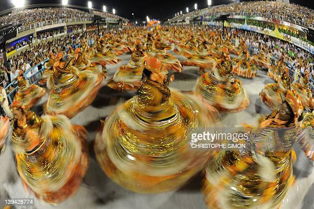 Revellers of Salgueiro samba school dance during the second night of carnival parade at the Sambadrome in Rio de Janeiro early on February 21 2012...