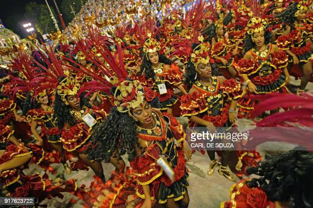 TOPSHOT Revellers of the Beija Flor samba school perform during the second night of Rio's Carnival at the Sambadrome in Rio de Janeiro Brazil on...