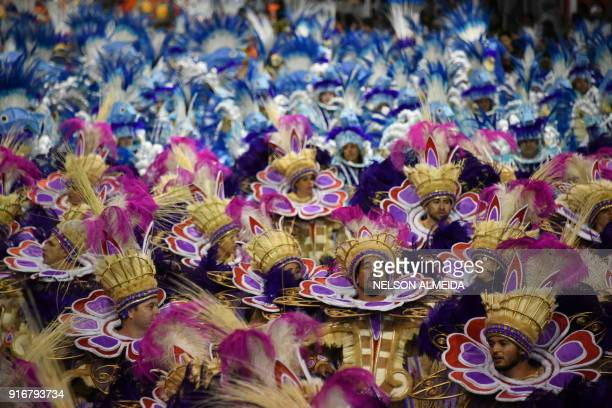 Revellers of the Gavioes da Fiel samba school perform during the second night of carnival in Sao Paulo Brazil at the city's Sambadrome early on...