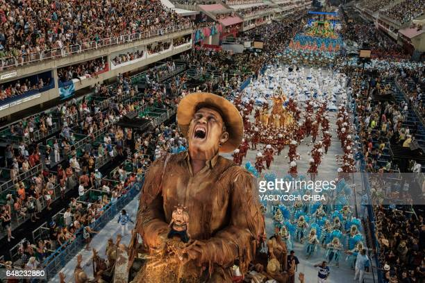 TOPSHOT Revellers of the Portela Samba School the champion of the 2017 Rio Carnival perform in the Champions' Parade at the Sambadrome in Rio Brazil...
