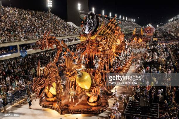 Revellers of the Salgueiro Samba School which came in third in the 2017 Rio Carnival perform during the Champions' Parade at the Sambadrome in Rio...