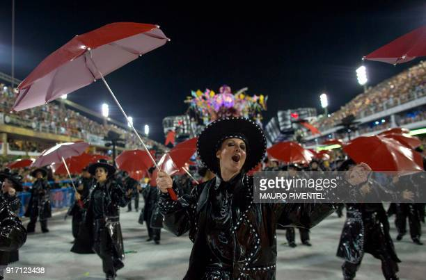 Revellers of the Sao Clemente perform on the first night of Rio's Carnival at the Sambadrome in Rio de Janeiro Brazil on February 11 2018 / AFP PHOTO...