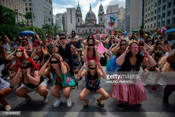 Revellers of the street carnival group Mulheres Rodadas perform the feminist flashmob song The Rapist is You a Chilean creation that went global...