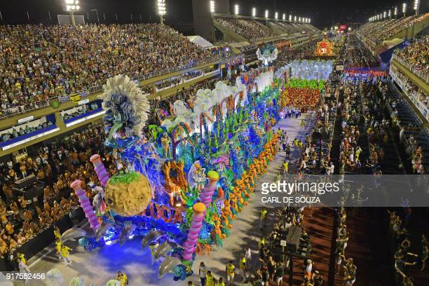 TOPSHOT Revellers of the Unidos da Tijuca samba school perform during the second night of Rio's Carnival at the Sambadrome in Rio de Janeiro Brazil...