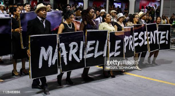 Revellers of the VaiVai samba school hold a banner honouring slain Rio de Janeiro councilwoman Marielle Franco as they perform during the second...