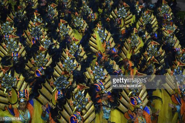 Revellers of the Vila Maria samba school perform during the second night of carnival in Sao Paulo Brazil at the city's Sambadrome in the early hours...