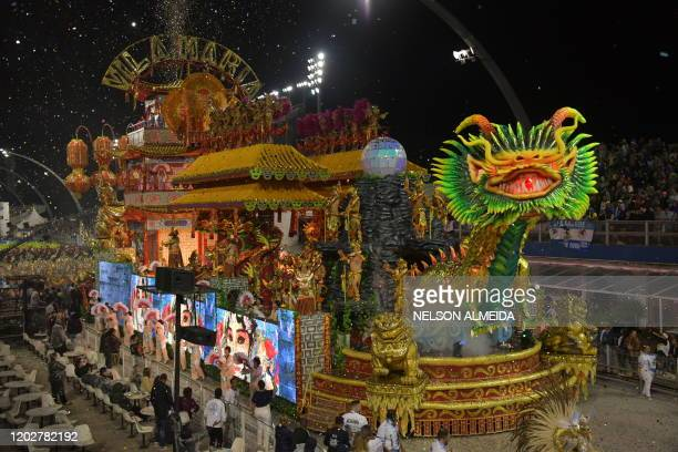 Revellers of the Vila Maria samba school perform on a float during the second night of carnival in Sao Paulo Brazil at the city's Sambadrome in the...