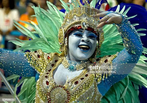 Revellers of Uniao da Ilha do Governador samba school perform during the first night of the carnival parade at Sambadrome in Rio de Janeiro Brazil on...