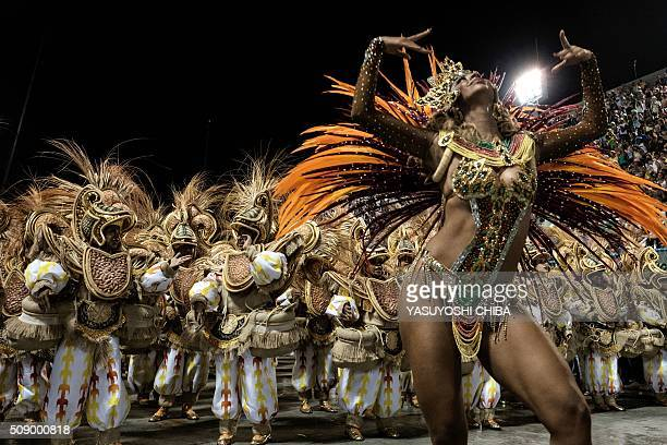 TOPSHOT Revellers of Unidos da Tijuca samba school perform during the first night of the carnival parade at Sambadrome in Rio de Janeiro Brazil on...