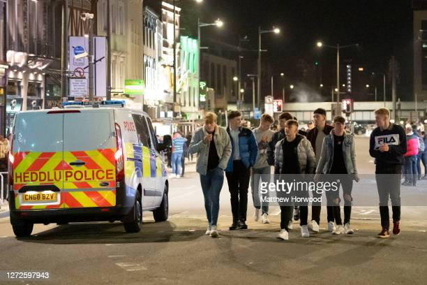 Revellers on St. Mary Street on September 13, 2020 in Cardiff, Wales. Lockdown rules have been tightened in Wales in an effort to reduce the number...