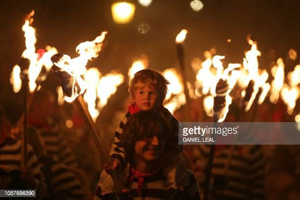 Revellers parade through the streets of Lewes in East Sussex southern England on November 5 during the traditional Bonfire Night celebrations...