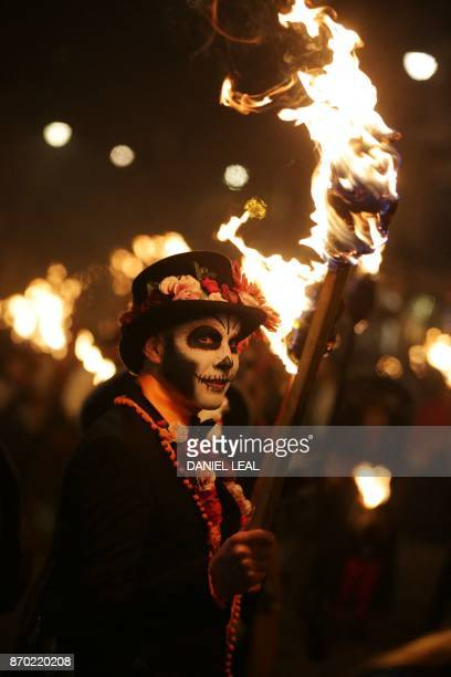 Revellers parade through the streets of Lewes in Sussex southern England on November 4 during the traditional Bonfire Night celebrations Thousands of...