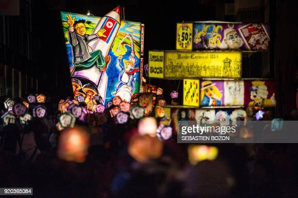 Revellers parade with lanterns depicting North Korean leader Kim Jong Un and US President Donald Trump during the traditional 'Morgestreich'...