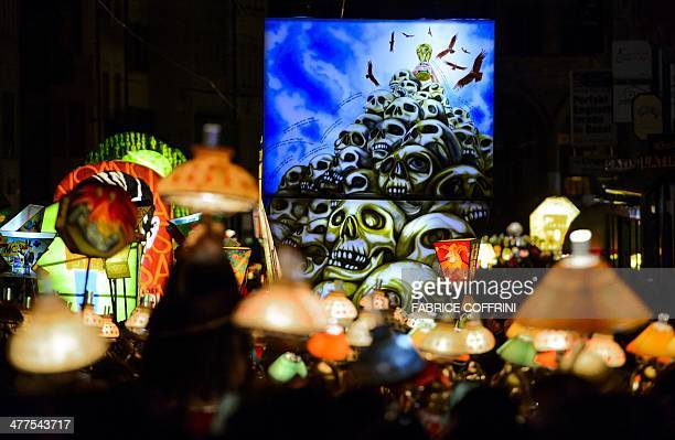Revellers parade with lanterns during the traditional 'Morgestreich' procession starting the carnival of Basel on March 10 2014 The threeday event...