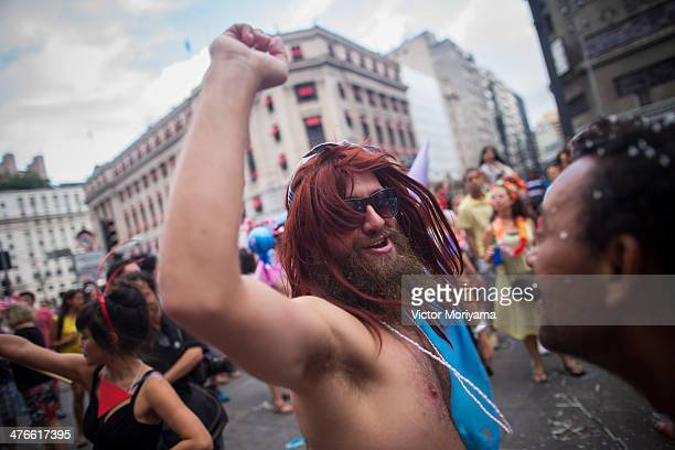 Revellers participate in a block street 'Lambuza' cross-dressing carnival, in which men and women dress up in each others clothes, on March 3, 2014...