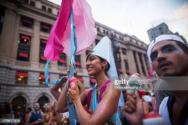 Revellers participate in a block street 'Lambuza' crossdressing carnival in which men and women dress up in each others clothes on March 3 2014 in...