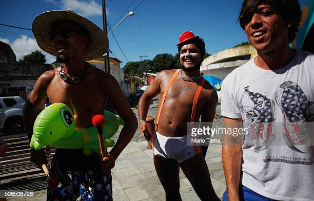 Revellers participate in a Carnival 'bloco' on the first official day of Carnival February 5 2016 in Olinda Pernambuco state Brazil Officials say as...