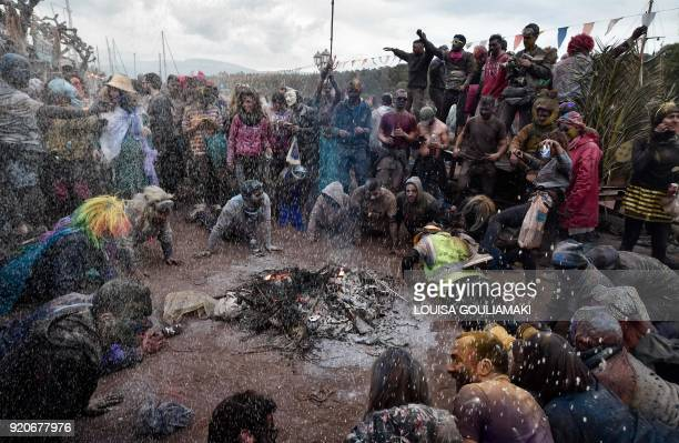 TOPSHOT Revellers participate in a 'flour war' and dance to carnival songs during 'Ash Monday' celebration a traditional festivity marking the end of...