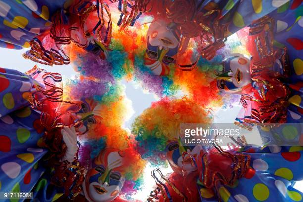 Revellers participate in a masked ball during Carnival celebrations in Maragojipe city, state of Bahia, Brazil, on February 11, 2018.