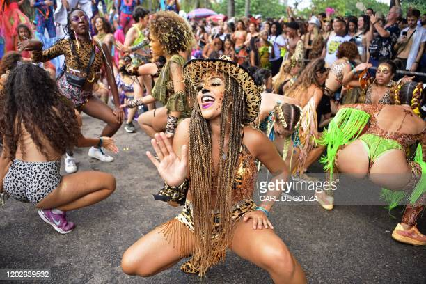 Revellers participate in the Amigos da Onca street party in Rio de Janeiro, Brazil, on February 22 ahead of Rio's annual world famous carnival. -...