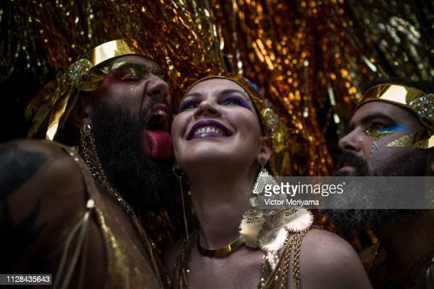 Revellers participate in the Carnival group Bloco Tarado Ni Você parade honoring the brazilian singer Caetano Veloso through the streets of downtown...