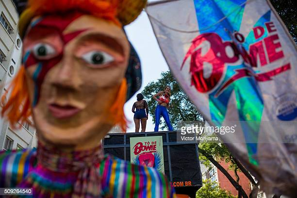 Revellers participate in the Carnival group parade honoring the singer David Bowie through the streets of downtown on February 9, 2016 in Sao Paulo,...